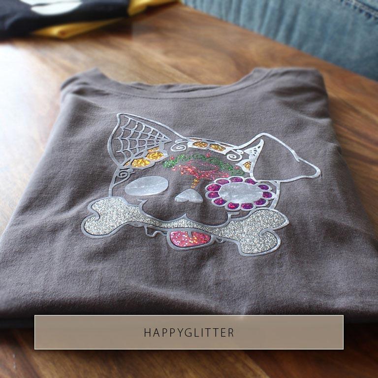 Tête de chien colorée de différents films thermocollants : os argenté de HappyGlitter